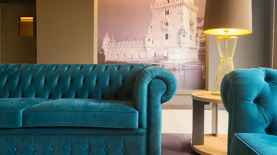 Lobby detail with blue sofas and abat-jour